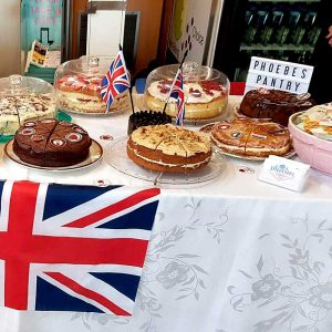 table decorated with union flag laid with lots of delicious cakes