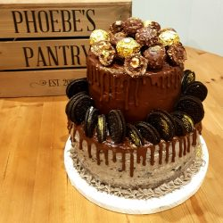 chocolate drip celebration cake with oreos and ferrero rocher decoration
